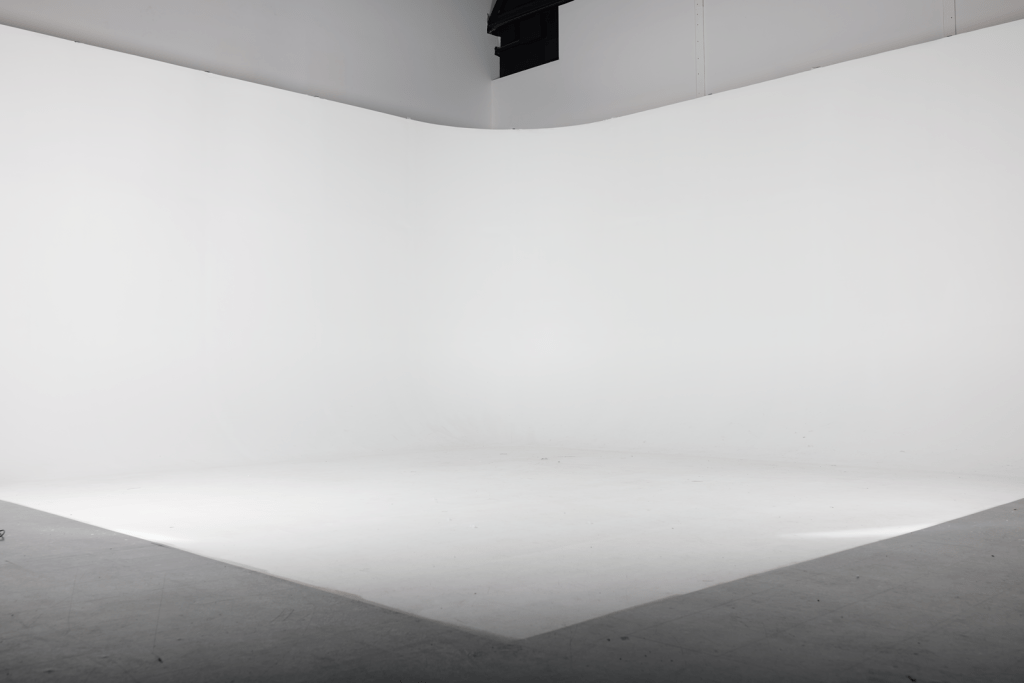 """A black and white photograph of our studio's infinity cyclorama. """"Infinity cyclorama"""" is a pretentious term for a backdrop that curves in such a way that there is no hard angle where the floor meets the wall. We use this to create stunning photography."""